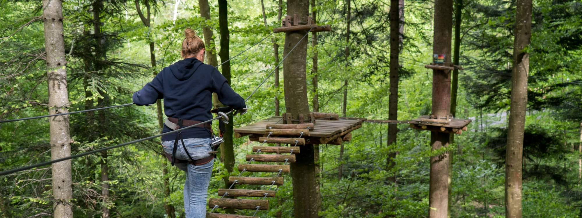 WOODEN BRIDGES, TARZAN SWINGS, AND ZIP LINES...